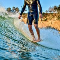 Longboarders surfing into Yamba